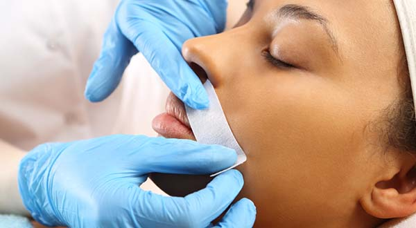woman getting upper lip waxed