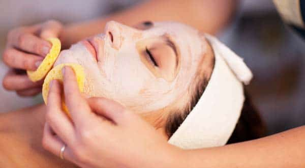 woman getting a facial to help with her acne