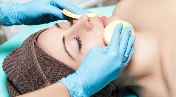 woman at a spa getting a deep cleaning facial