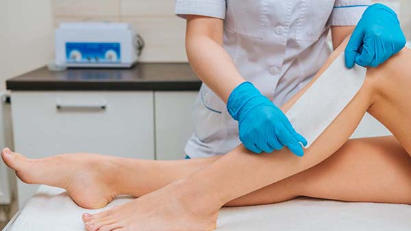 person having leg and body waxed