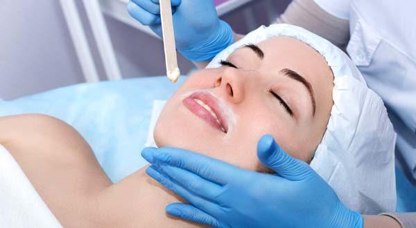 woman relaxing getting a face wax